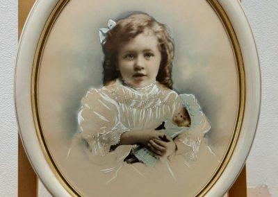 oval framed image of girl