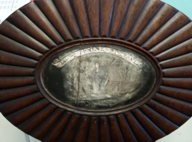 damaged crest on chair