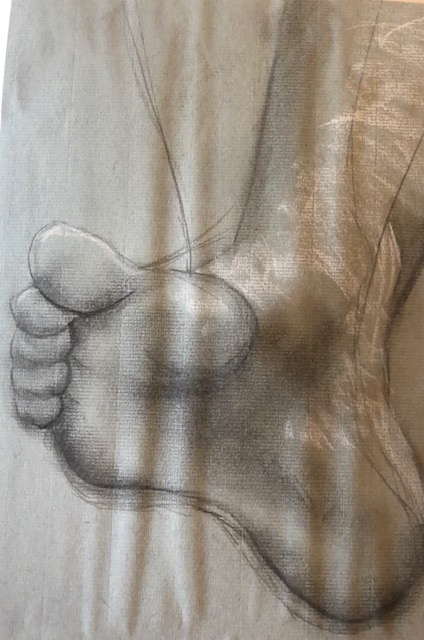 foot on pastel paper