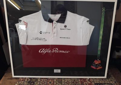 framed signed shirt