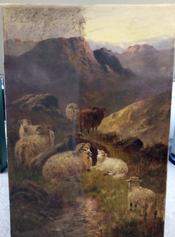 Right half of the painting has been cleaned to show the difference