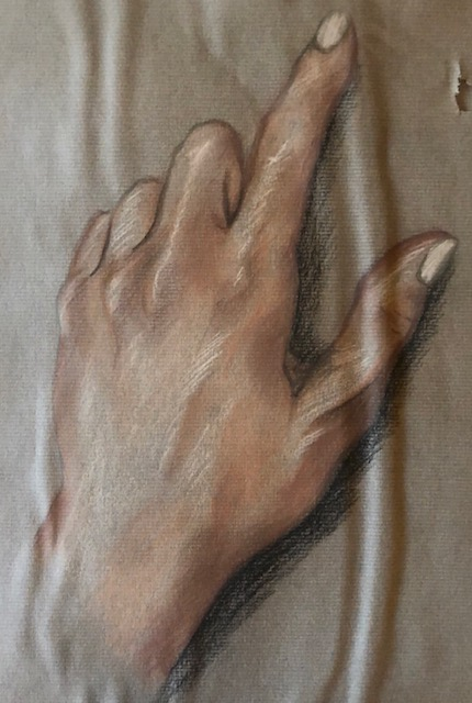 hand on pastel paper with coloured pencils