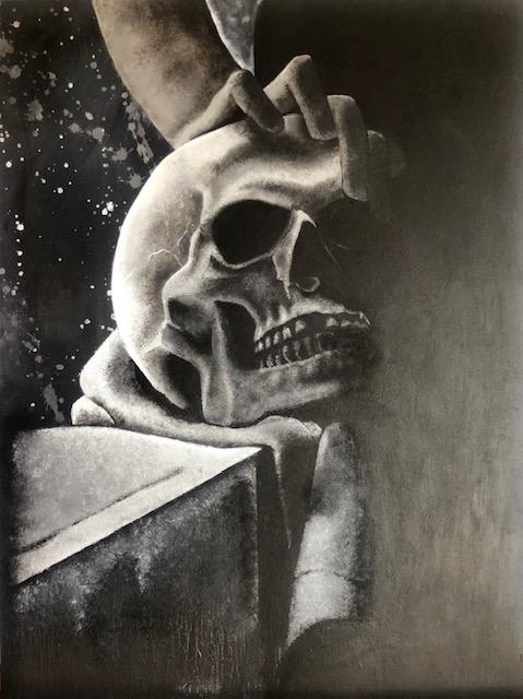 memorial stone sculpture featuring a skull