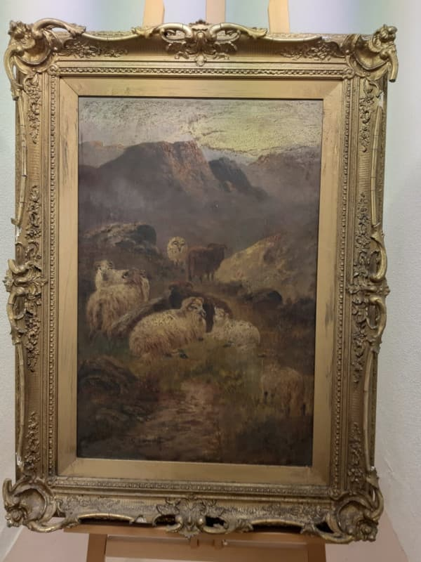 oil painting in the frame before restoration