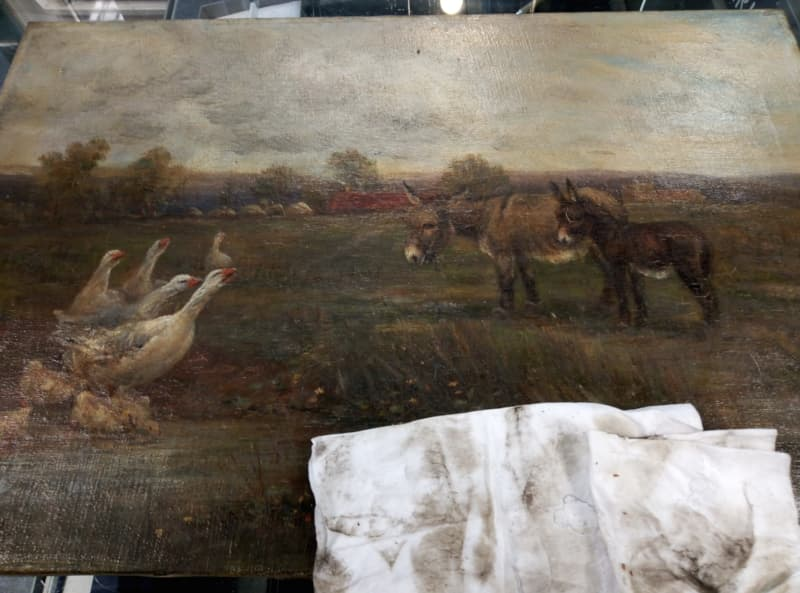 oil painting cleaning started - showing dirty cleaning cloth