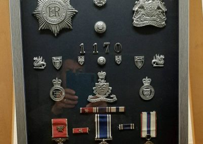 Framed policemans awards