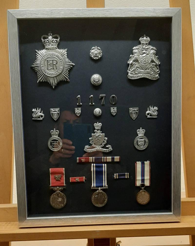 Framed policemans awards