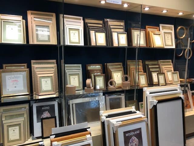 Shelf full of ready made frames
