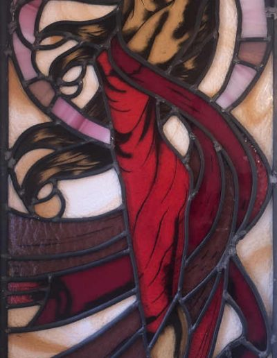 stained glass woman in a red dress