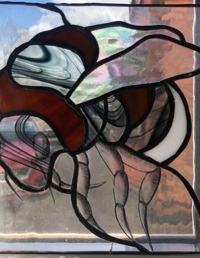 Stained glass picture of a bee